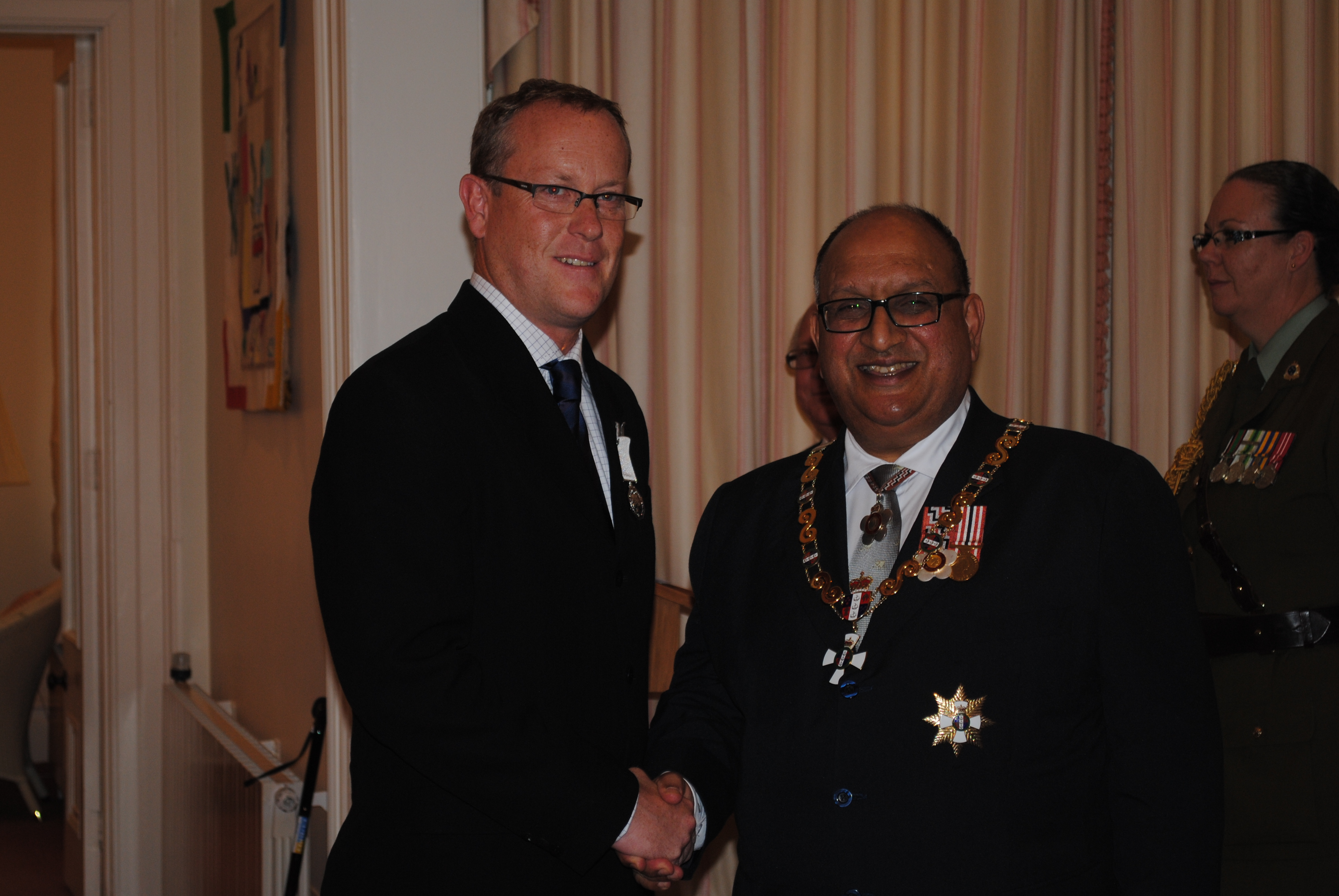 Naish (left), after being presented with the [[New Zealand Antarctic Medal