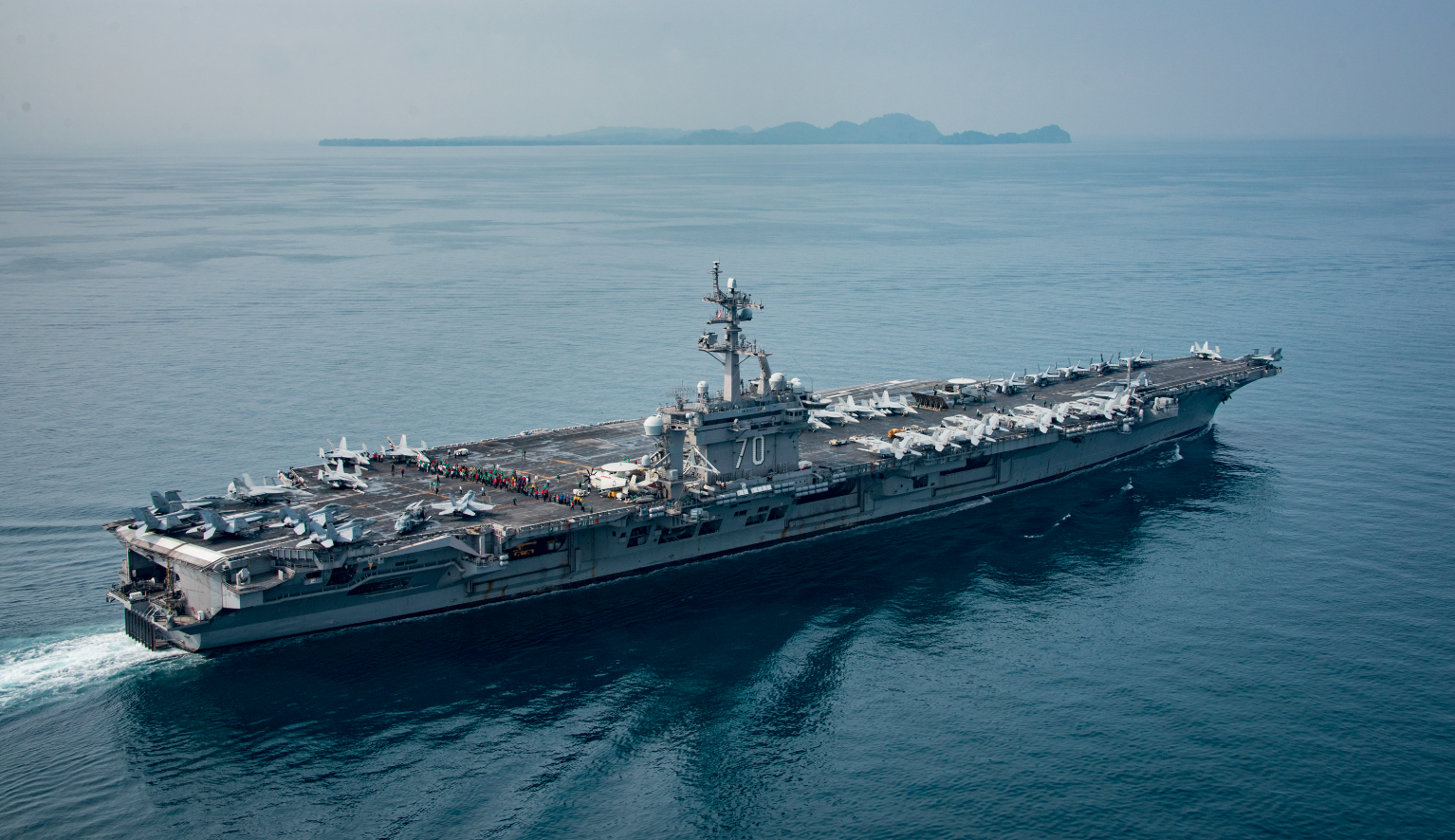 Photograph of the Carl Vinson on April 15, 2017 published by the U.S. Navy, showing the aircraft carrier crossing the Sunda Strait, sailing in the opposite ...