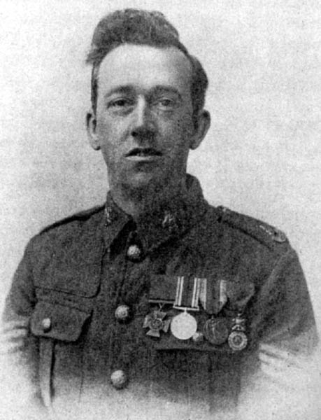 A man in British Army uniform of the Sherwood Foresters, with sergeant's stripes and wearing 4 medals, the Victoria Cross, British War Medal, Victory Medal and the French Medaille Militaire