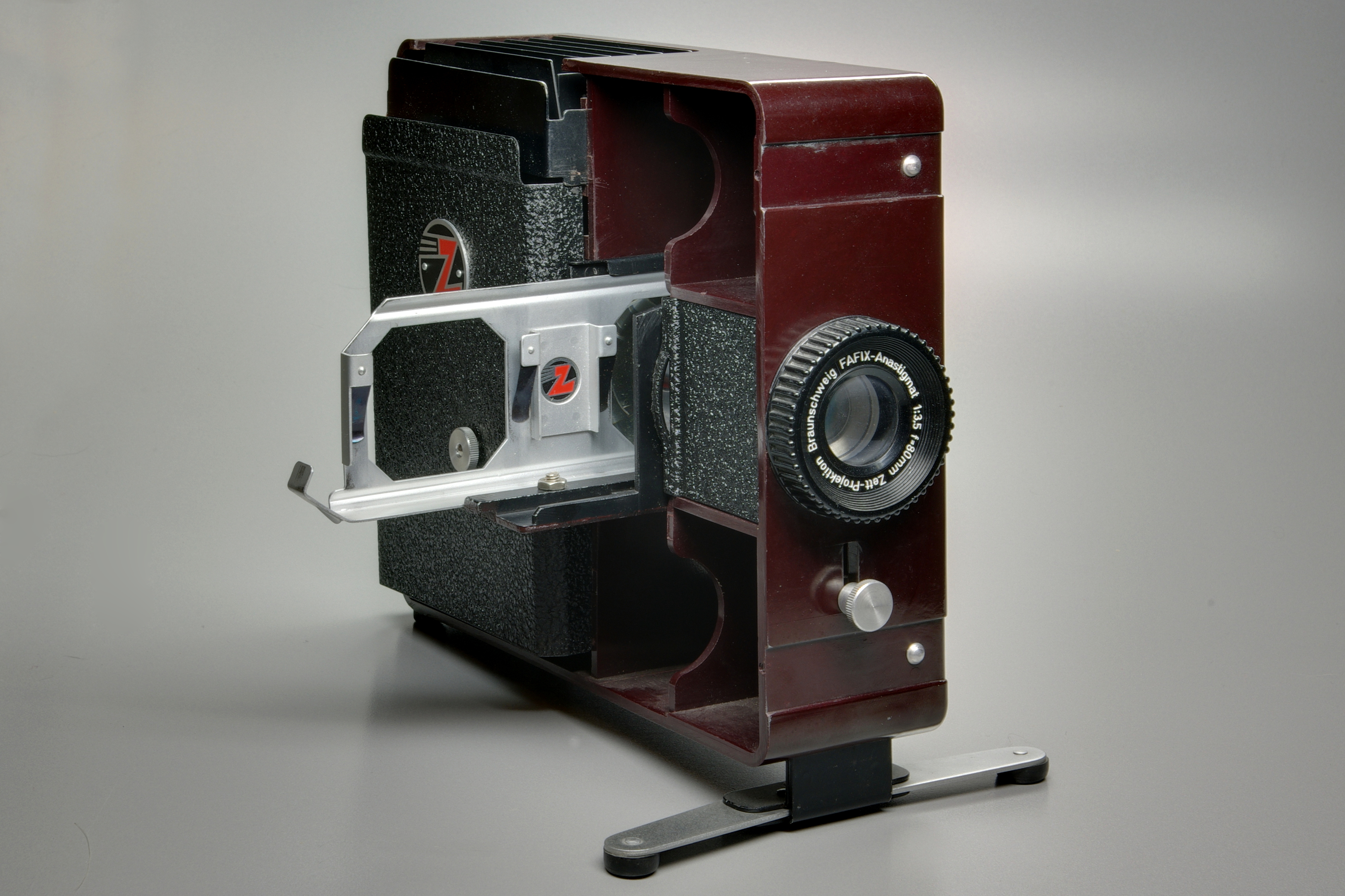 Color printing vs black and white cost - A Slide Projector Showing The Lens And A Typical Double Slide Carrier