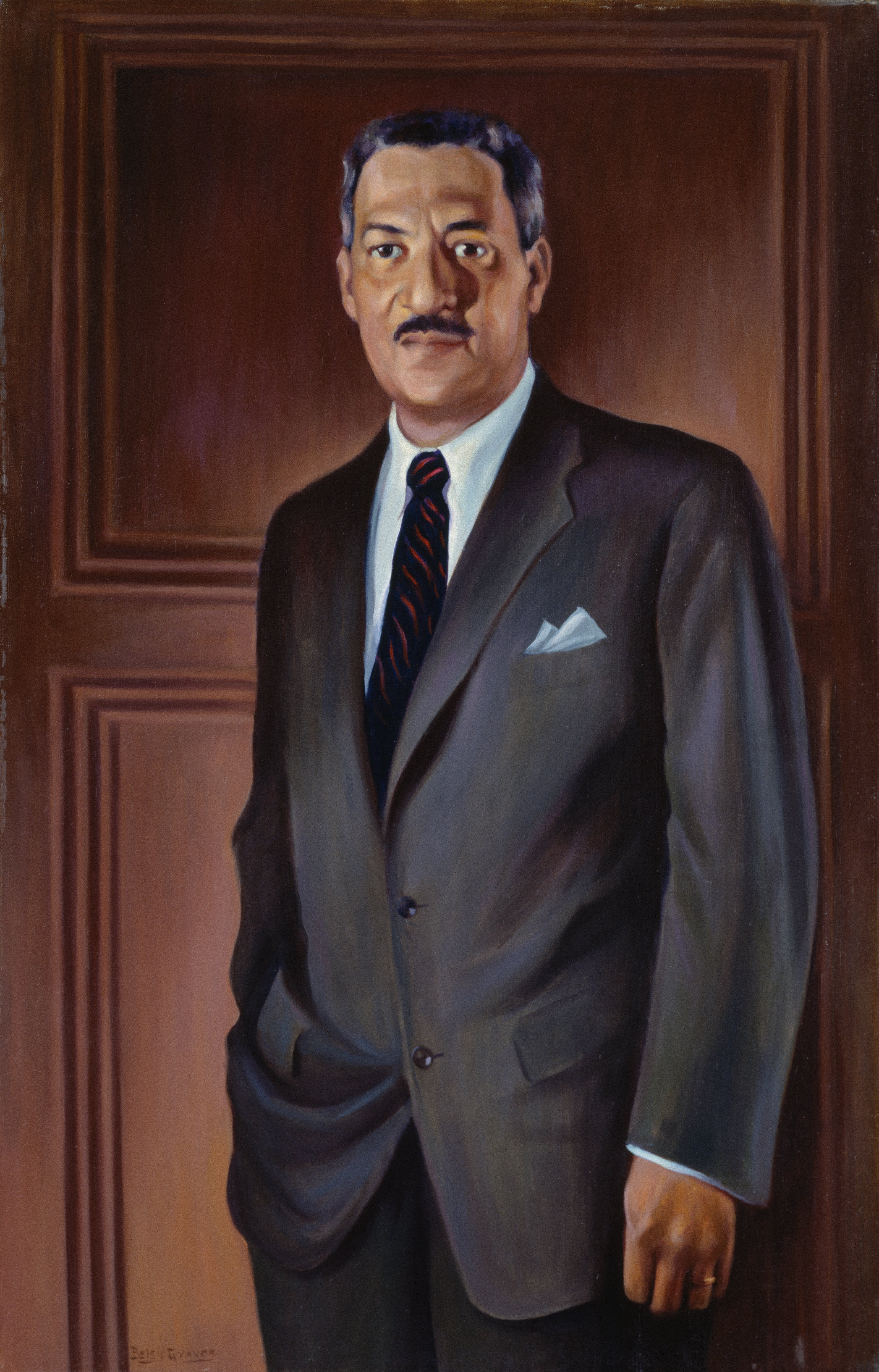Oil on canvas of Thurgood Marshall standing before a wood panelled wall.