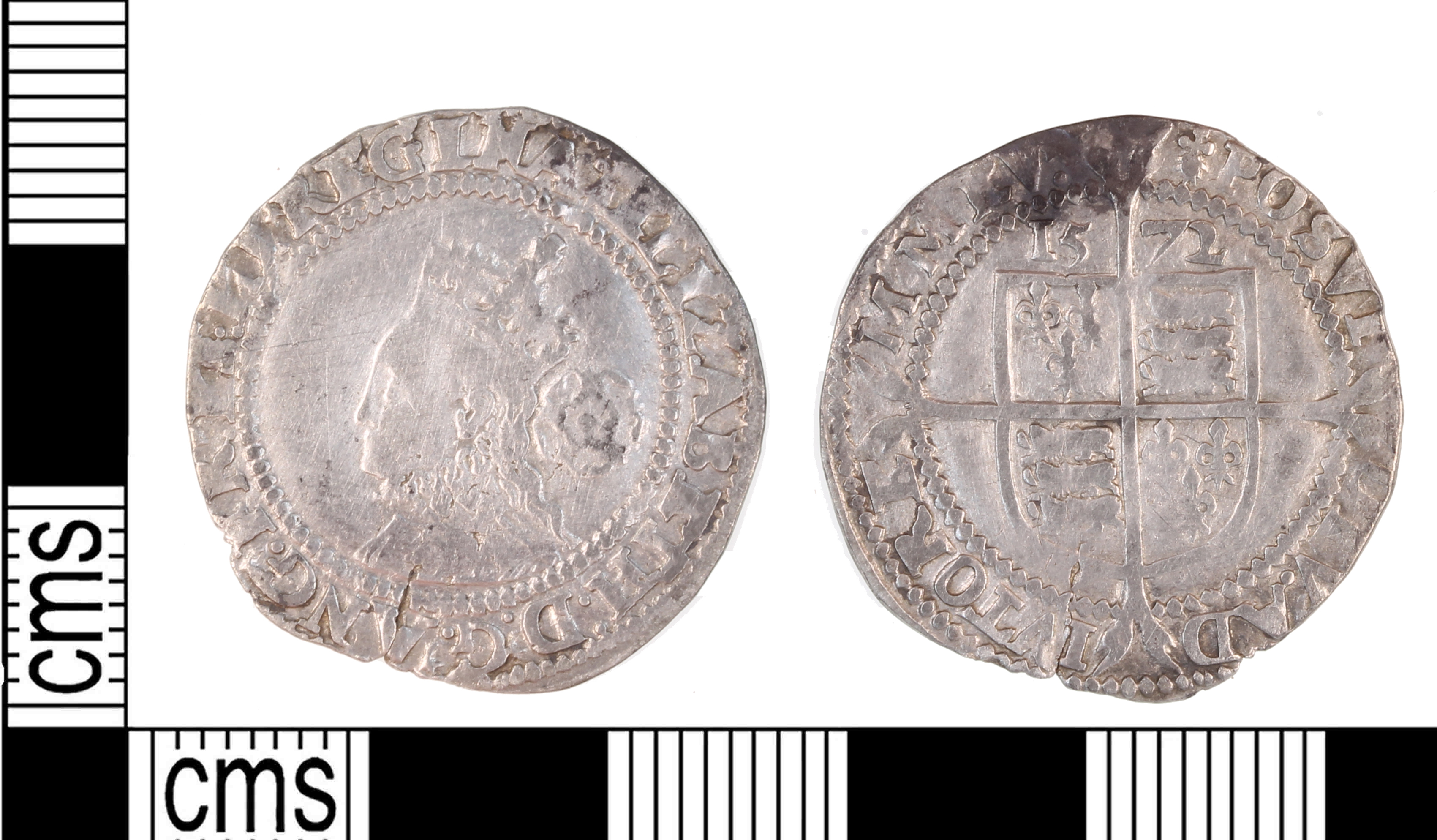 An image of an Elizabethan sixpence, a common feature of money folklore.