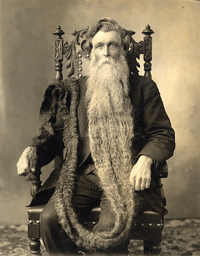 Hans Langseth.jpg  Hans Langseth seated in ornate chair with beard draped over his shoulder and down to his hand, 1910-1919,