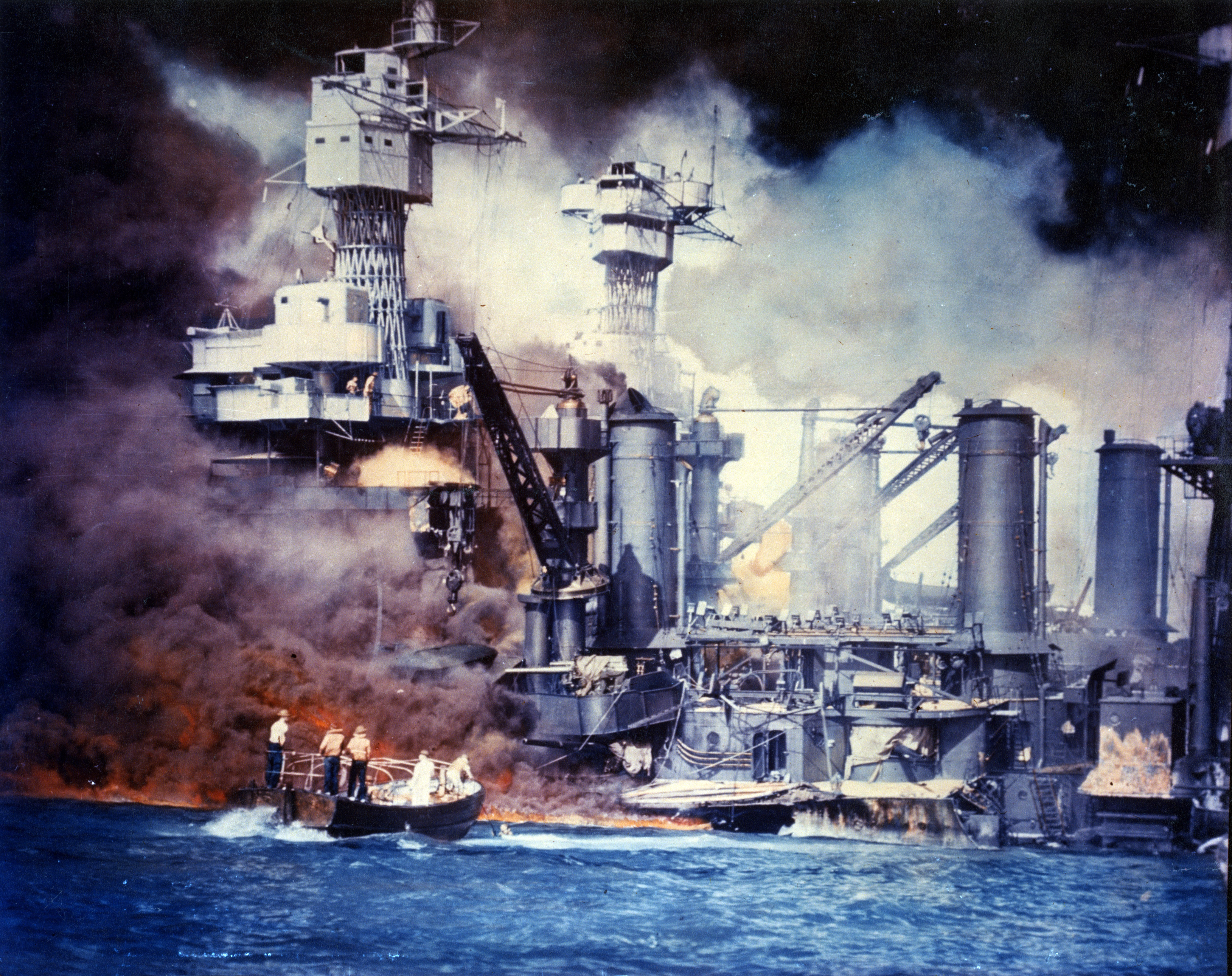 U.S. Navy sailors rescue survivors from the USS West Virginia during the Japanese air raid on Pearl Harbor, 7 December 1941. (Credit: U.S. Navy)