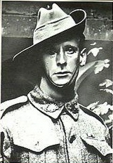 A slightly grainy head and shoulders portrait of a man in military uniform. He is wearing a slouch hat, with the strap coming down under his chin.