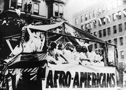 "This parade float displayed the word ""Afro-American"" in 1911. 1911 Golden Potlatch - Afro-Americans.jpg"