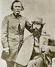 Frémont (seated right)and Kit Carson, Frémont's expeditions guide.