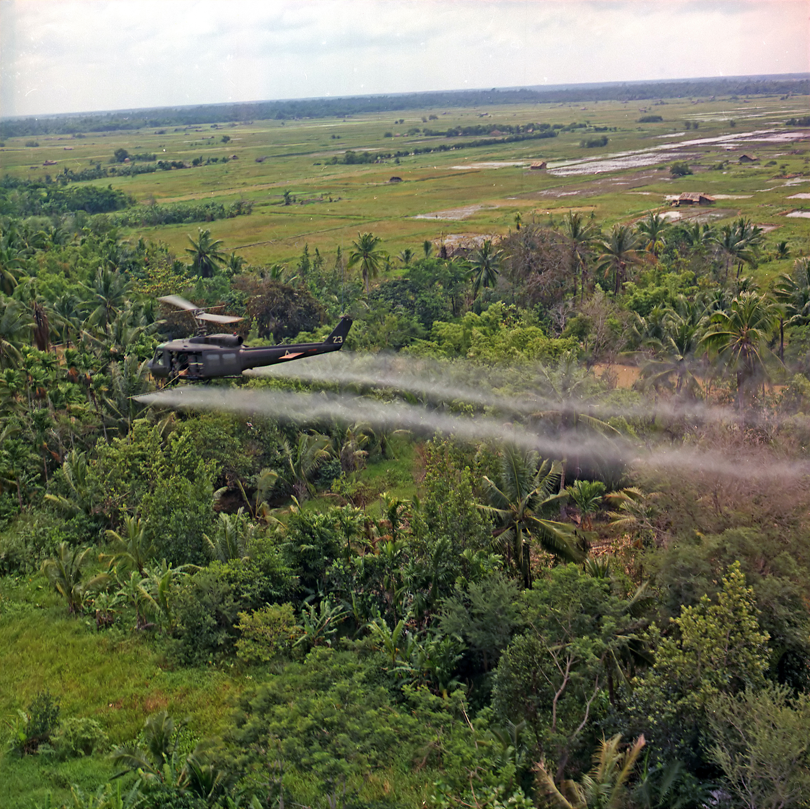 http://upload.wikimedia.org/wikipedia/commons/8/82/Defoliation_agent_spraying.jpg