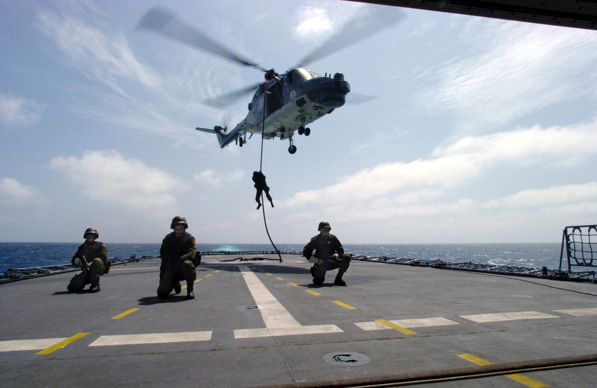 File German sol rs fast rope from Sea Lynx on frigate Koeln F211