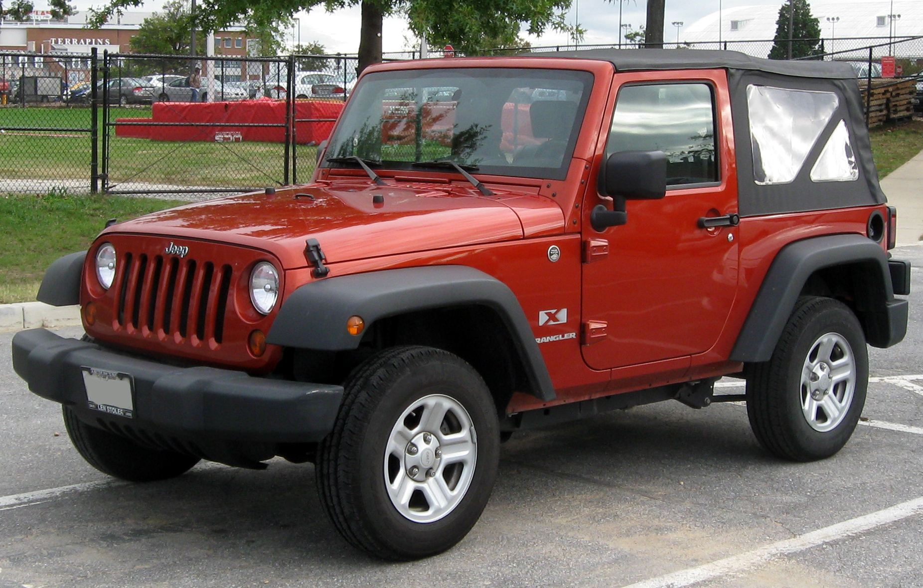 Red Jeep Wrangler in parking lot