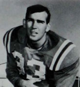 College football player Jim Holder wearing his #33 jersey and posing with a football for a publicity picture