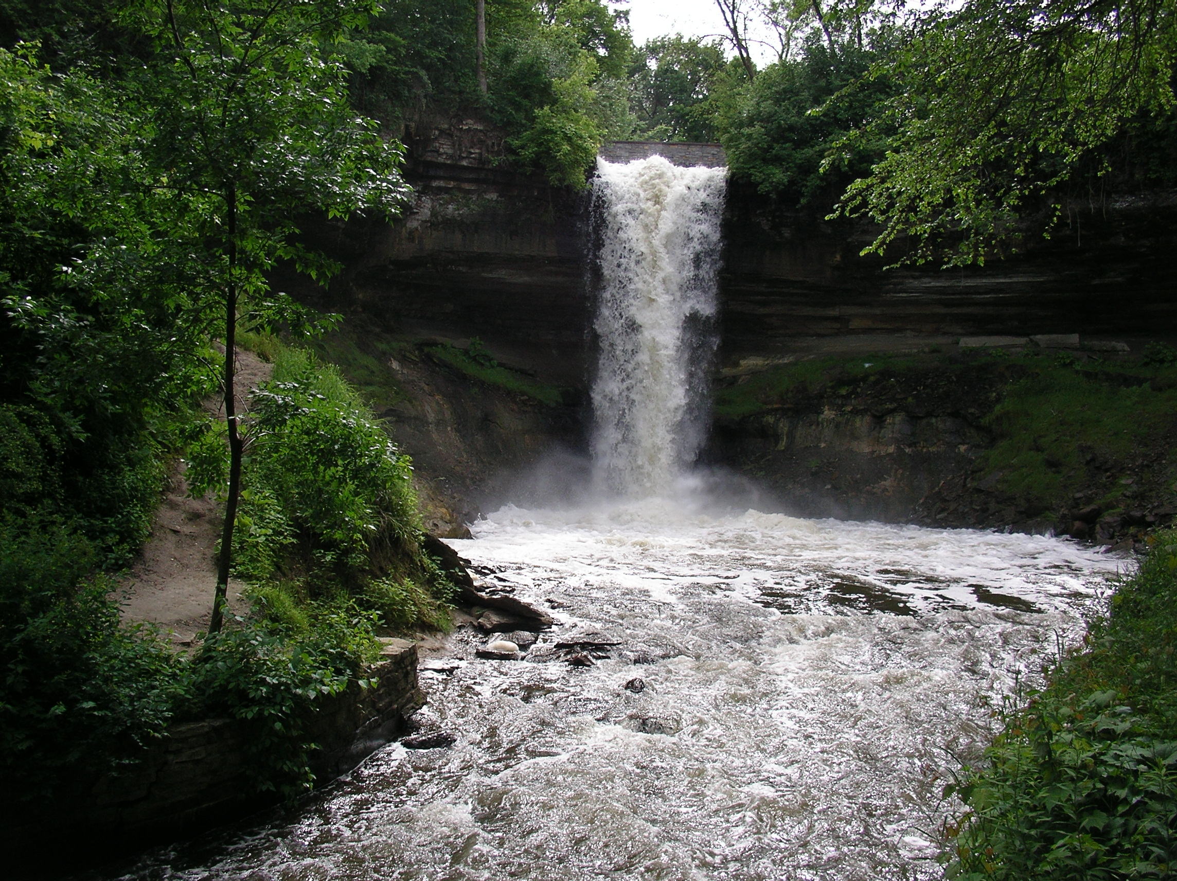 Minnehaha Falls surrounded by dark green summer foilage