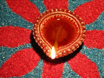 Oil lamp on rangoli