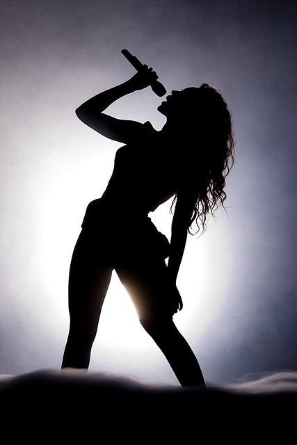 a silhouette of Beyoncé on stage