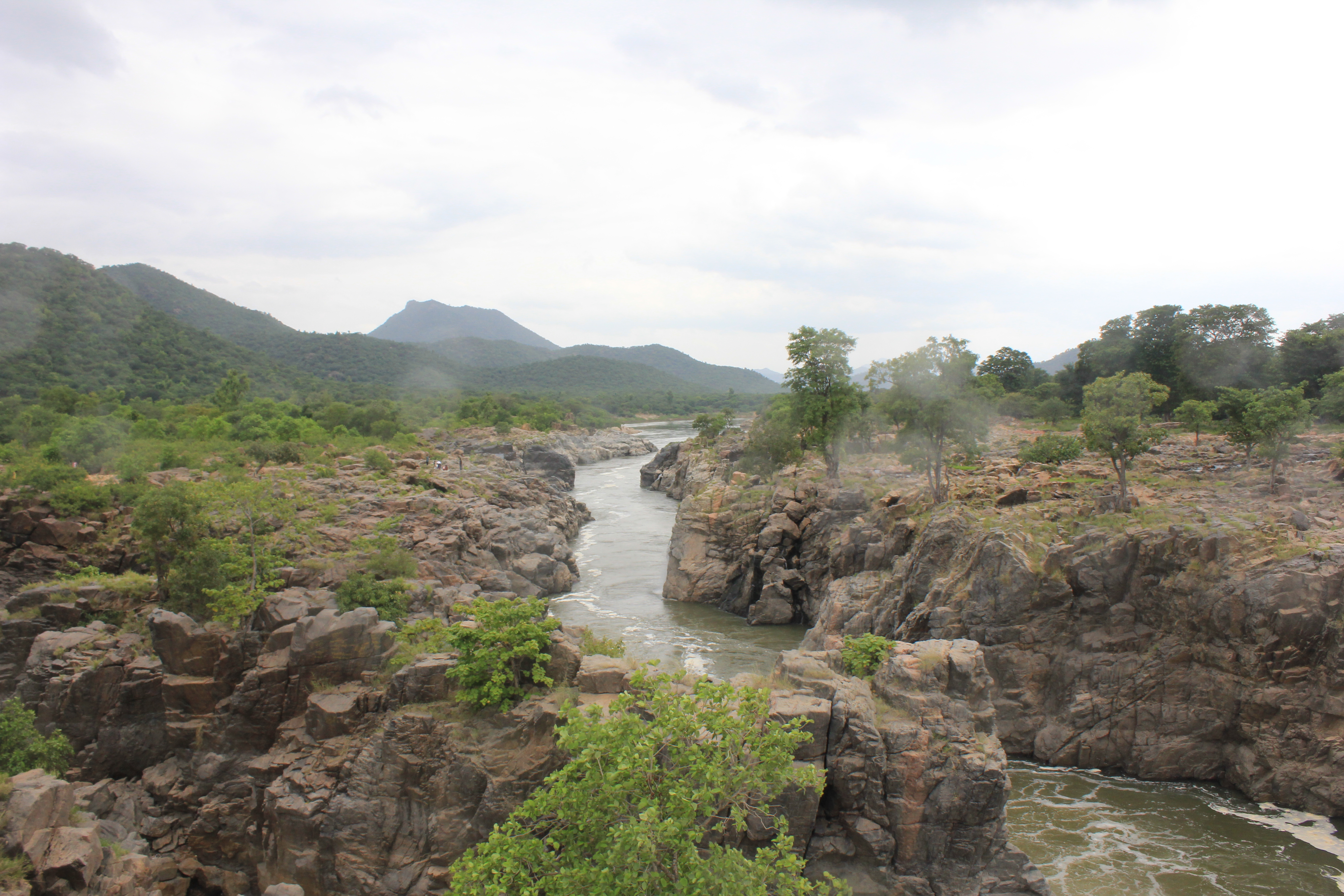 File cauvery river water flowing amidst rocky for River hill
