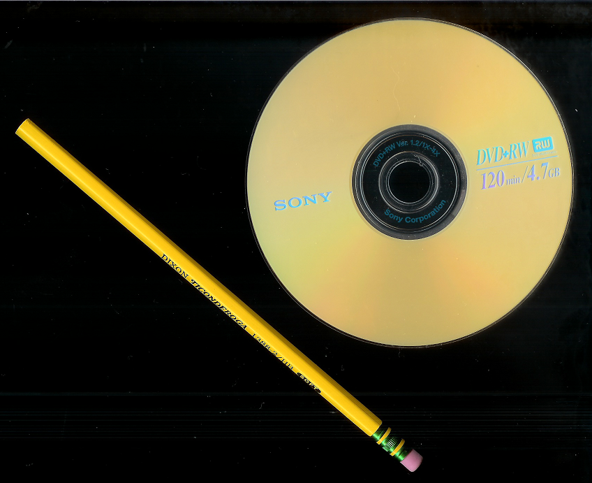 Size comparison: a 12 cm DVD+RW and a 19 cm pencil.