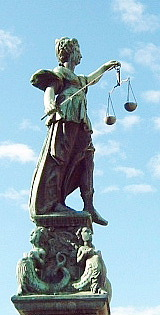 Sculpture of Lady Justice on the Fountain of Justice (Gerechtigkeitsbrunnen) in Frankfurt, Germany.