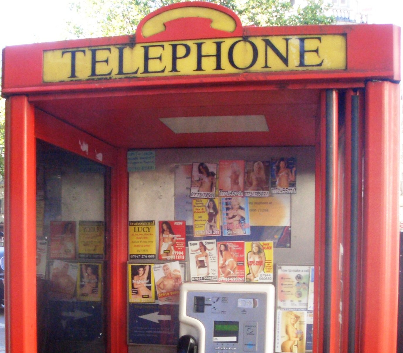 filephone box prostitute calling cards 1 cropjpg - Phone Calling Cards