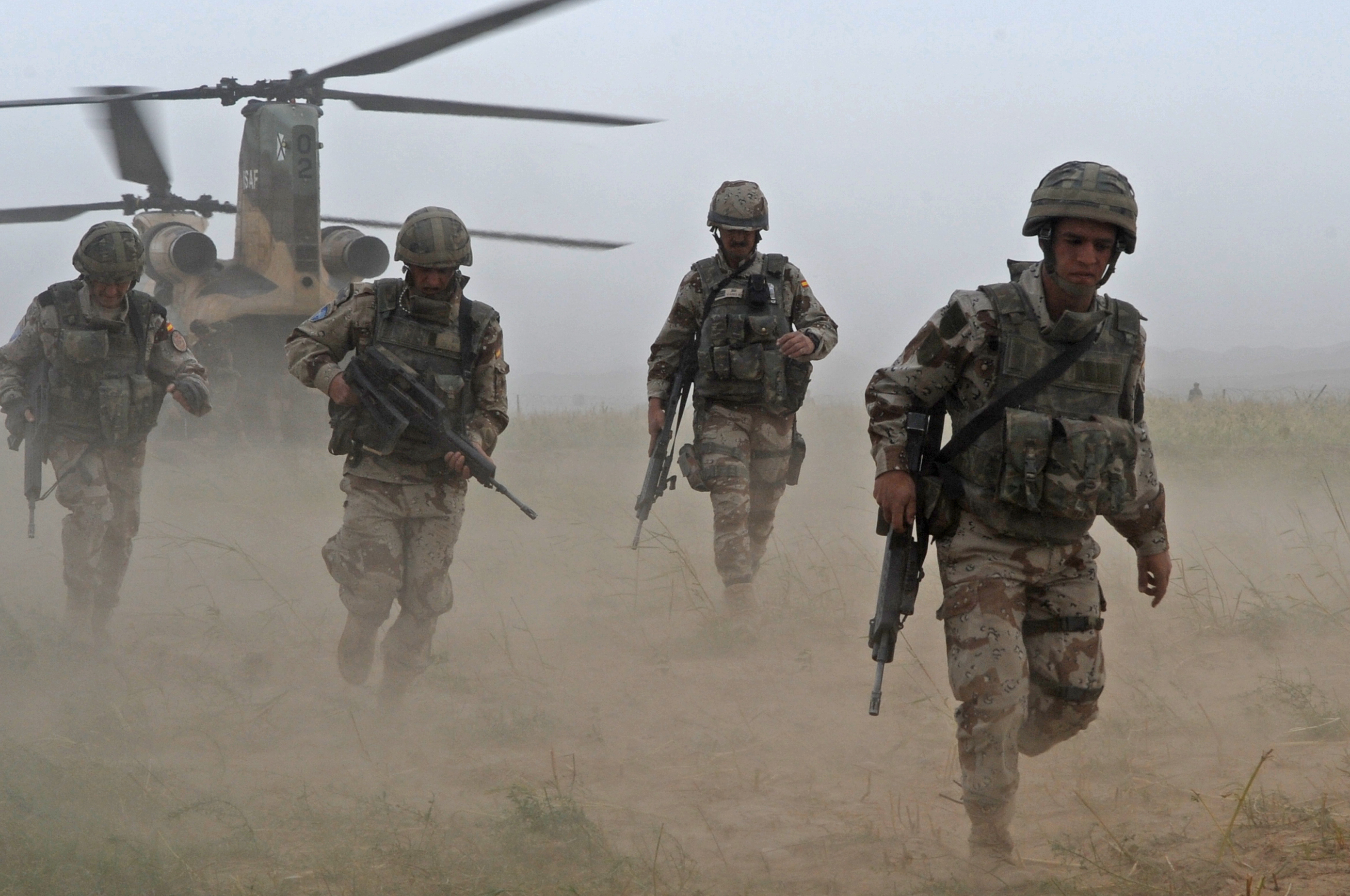 Spanish army paratroopers from the 3rd Bandera exit a CH-47 Chinook helicopter at Bala Murghab Forward Operating Base Afghanistan
