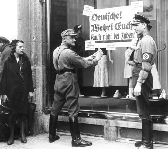 The SA not only instigated street violence against Jews, Communists and Socialists, it also enforced boycotts against Jewish-owned business, such as this one in Berlin in 1933. - Wikipedia