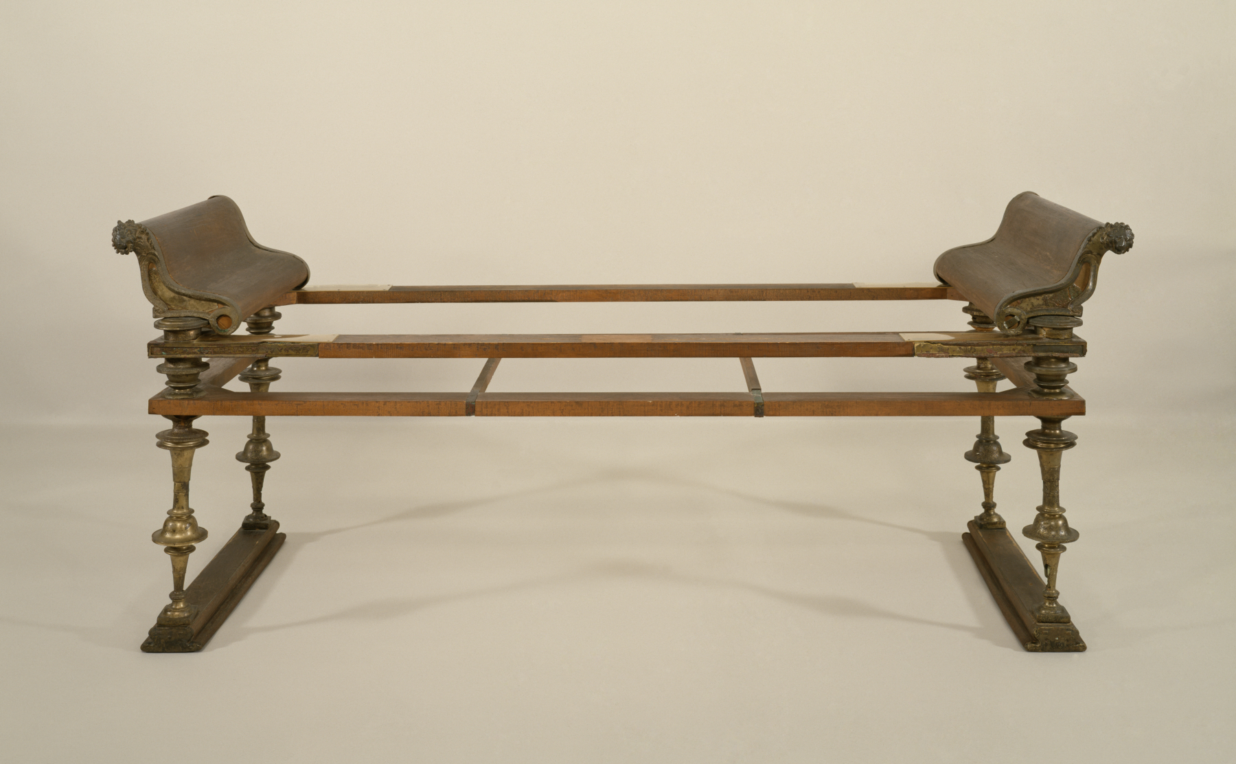 Roman dining couch or klinē, in metal and reconstructed wood with couch heads (referred to as Fulcra).