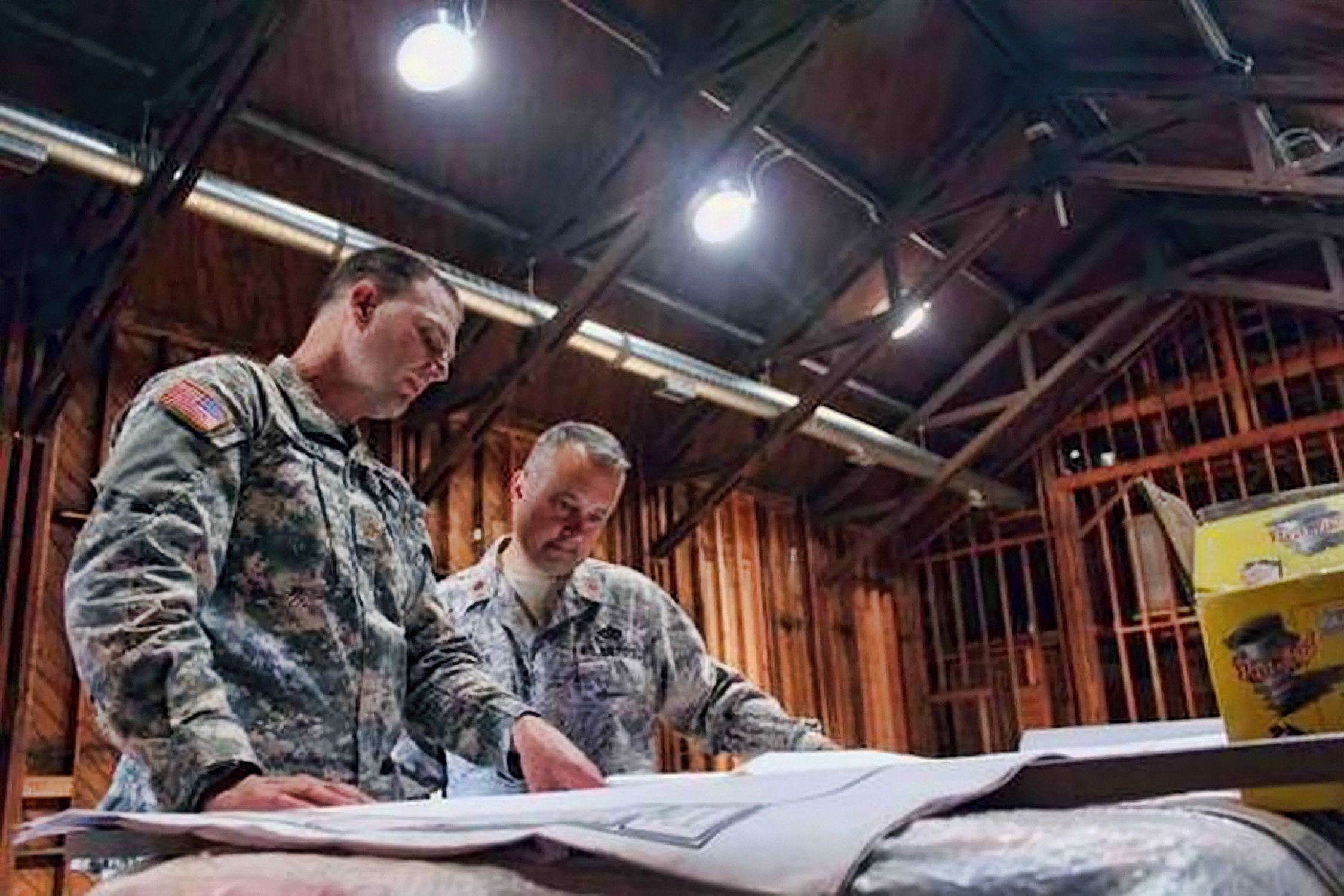 Air Force Reserve, Army units collaborate on World War II chapel renovations 140911-F-JB957-002.jpg English: Maj. Matthew Weeks (left) JBLM Directorate