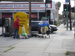 English: Dumpster diving in Highland Park, a n...