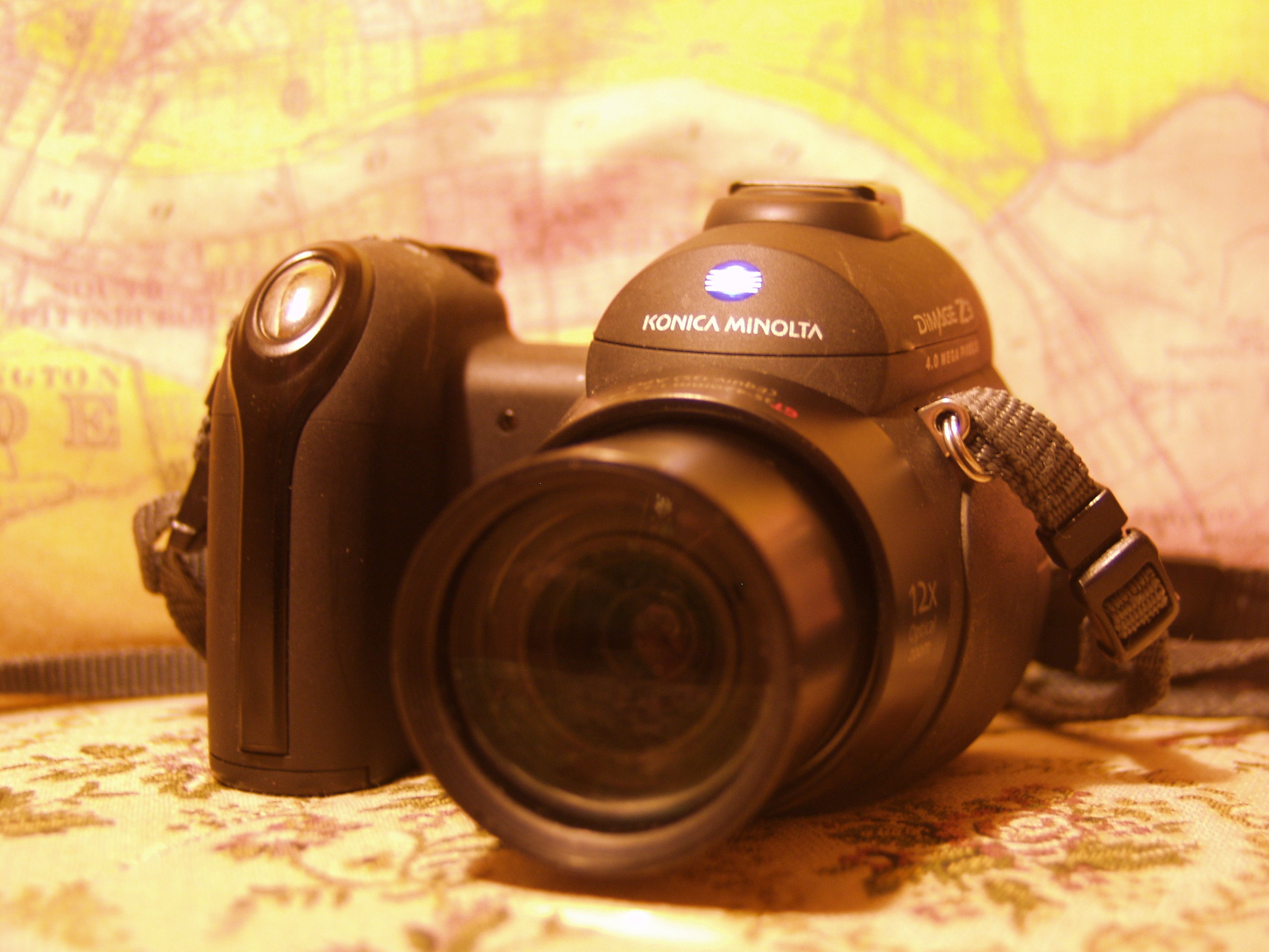 """Konica-Minolta DiMAGE Z3. """"DiMAGE"""" is a stupid name, but this is Father  Pitt's favorite camera: it cost him 99¢ plus shipping, and it was worth  every penny."""