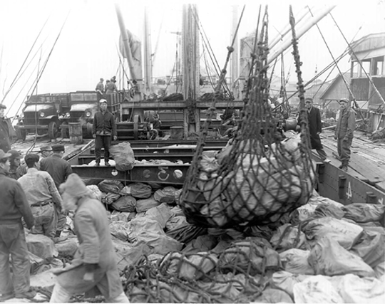 Merchant ship delivers mail to combat troops in Korean War