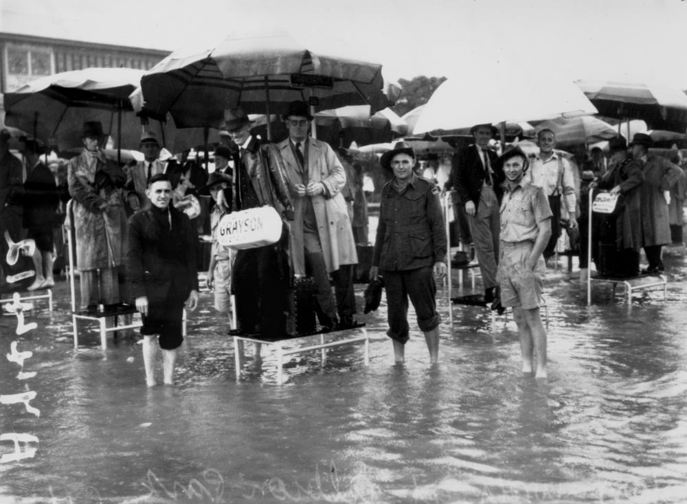 File:StateLibQld 1 111316 Floods in the bookmaker's ring at Albion ...