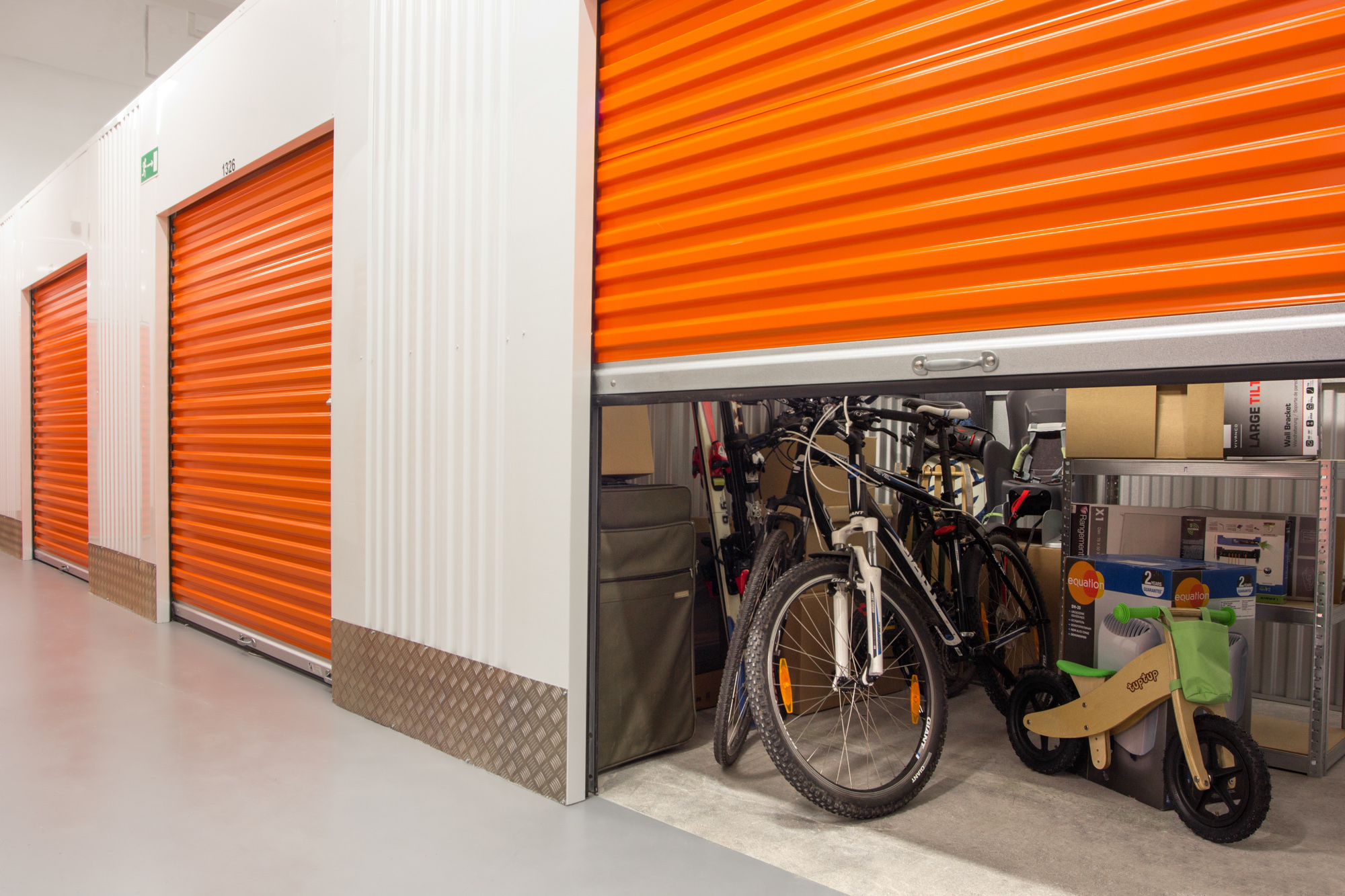 self storage unit with household goods and 3 bikes