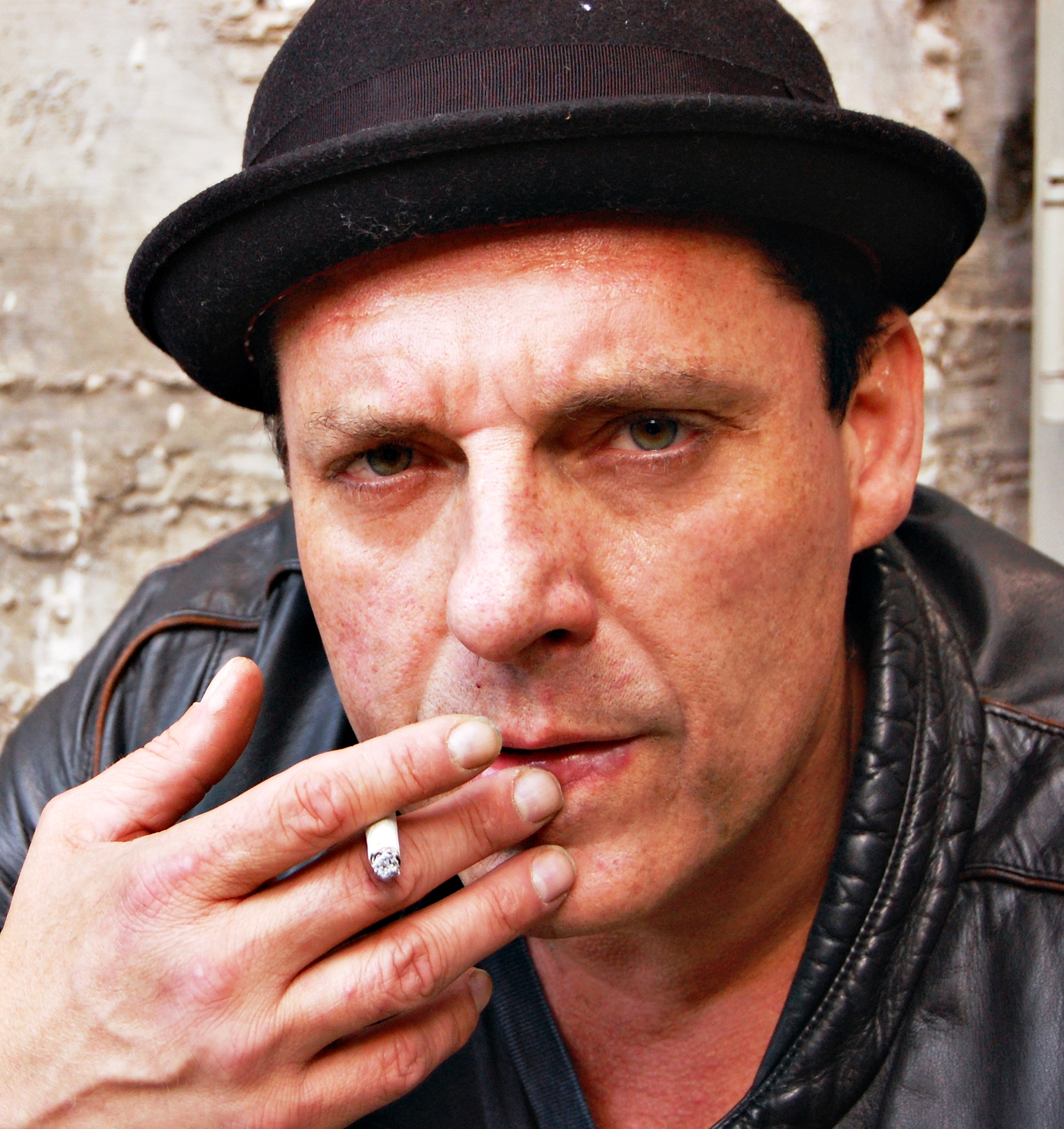 Tom Sizemore smoking a cigarette (or weed)