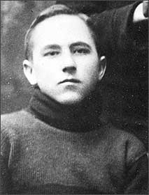 Head and shoulders of unsmiling young man in a turtleneck sweater