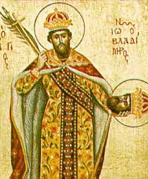 Religious painting of a man wearing a crown, a cloak, and a robe with floral designs, holding a cross, a scepter, and a leafed branch in his right hand, and a severed human head in his left hand.