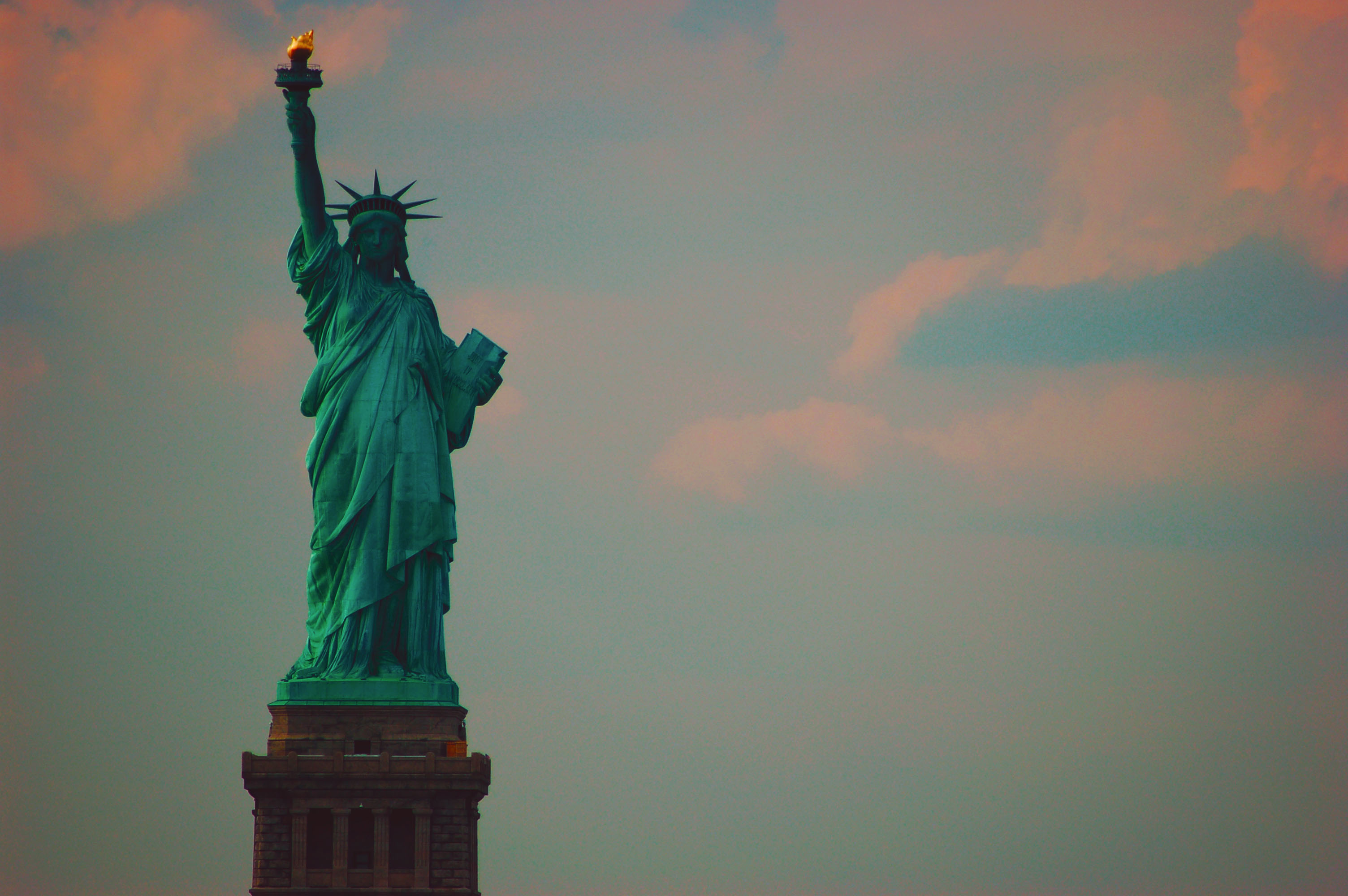 Lady Liberty Sunset. The Statue of Liberty, taken from the Staten Island Ferry