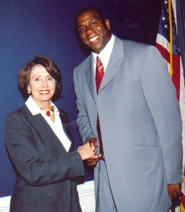 A middle-aged Caucasian woman shakes the hand of a tall black man.