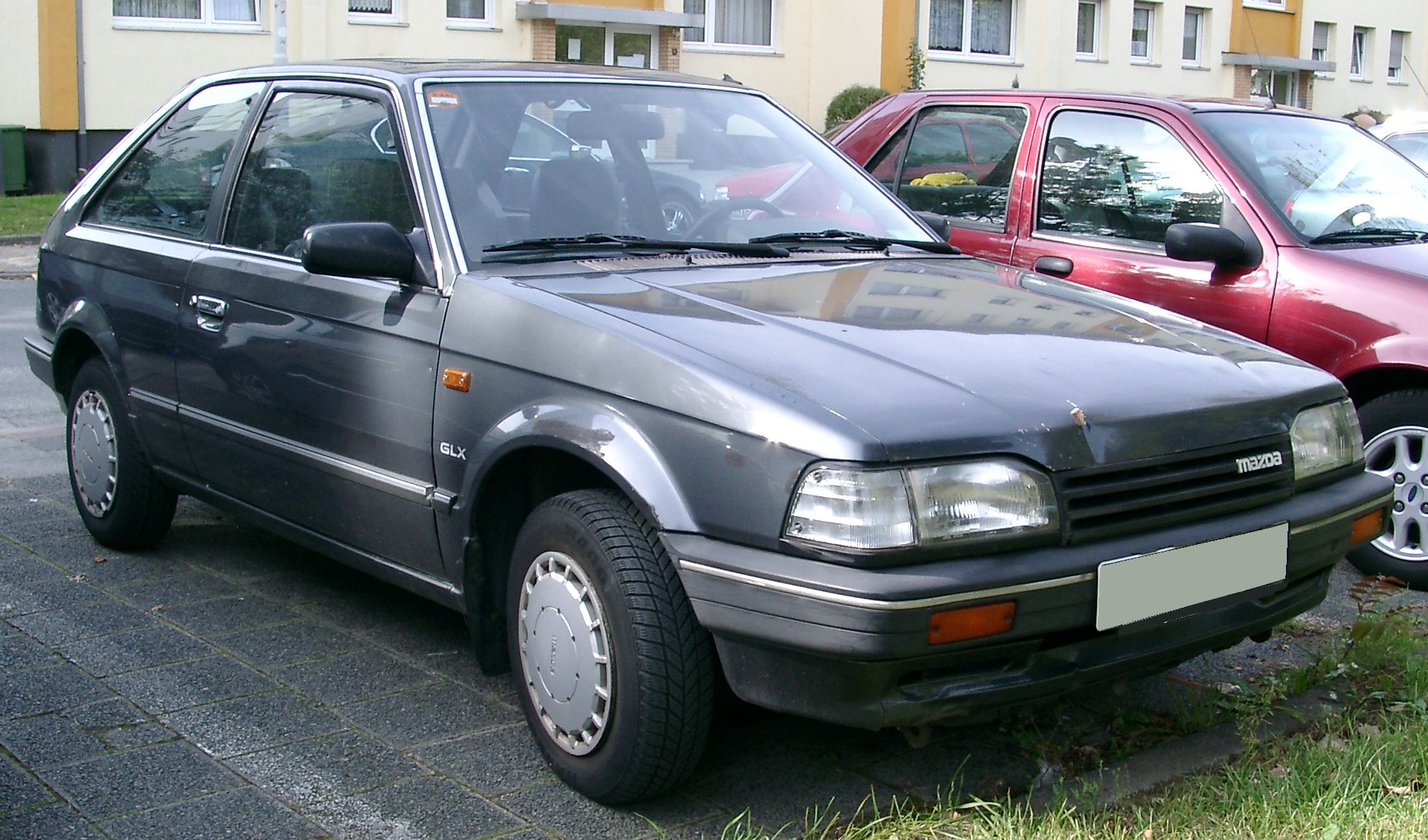 File:Mazda 323 front 20070920.jpg