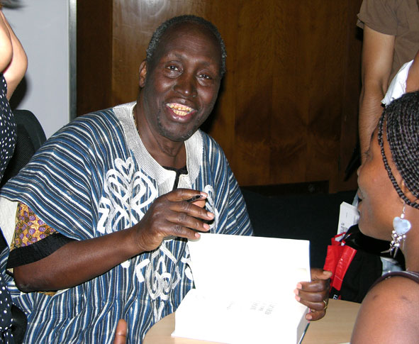Ngũgĩ wa Thiong'o signs copies of his book ''[[Wizard of the Crow]]'', at the Congress Centre in central London, 2007