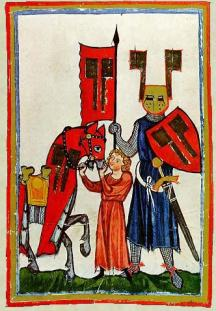 Medieval knight with a boy holding his horse.