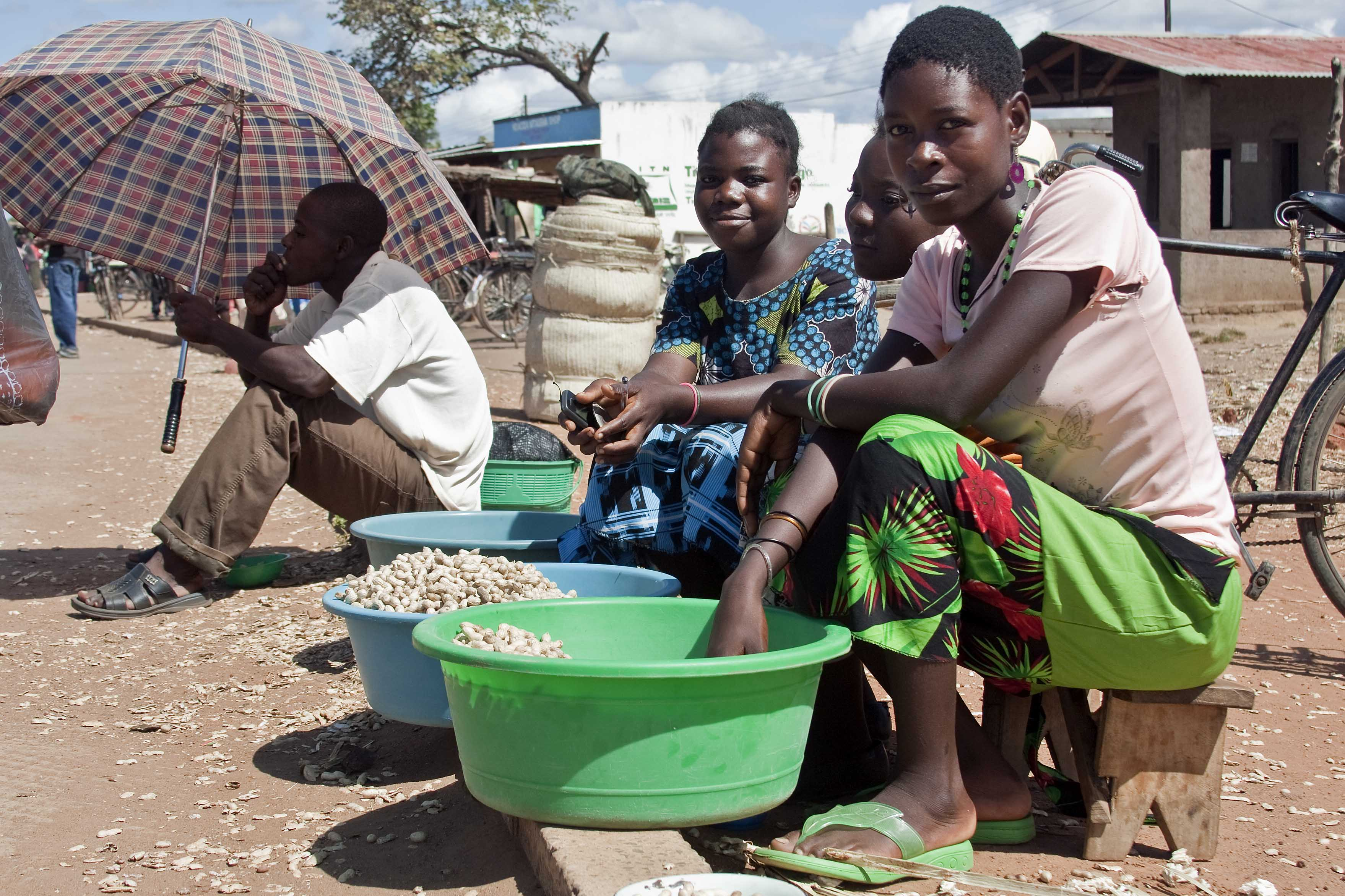 Women in Salima District, Malawi, selling groundnuts