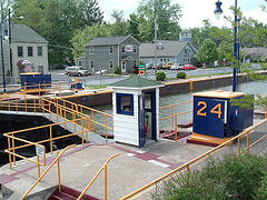 The modern Erie Canal has 34 locks, which are painted with the blue and gold colors of the New York State Canal System