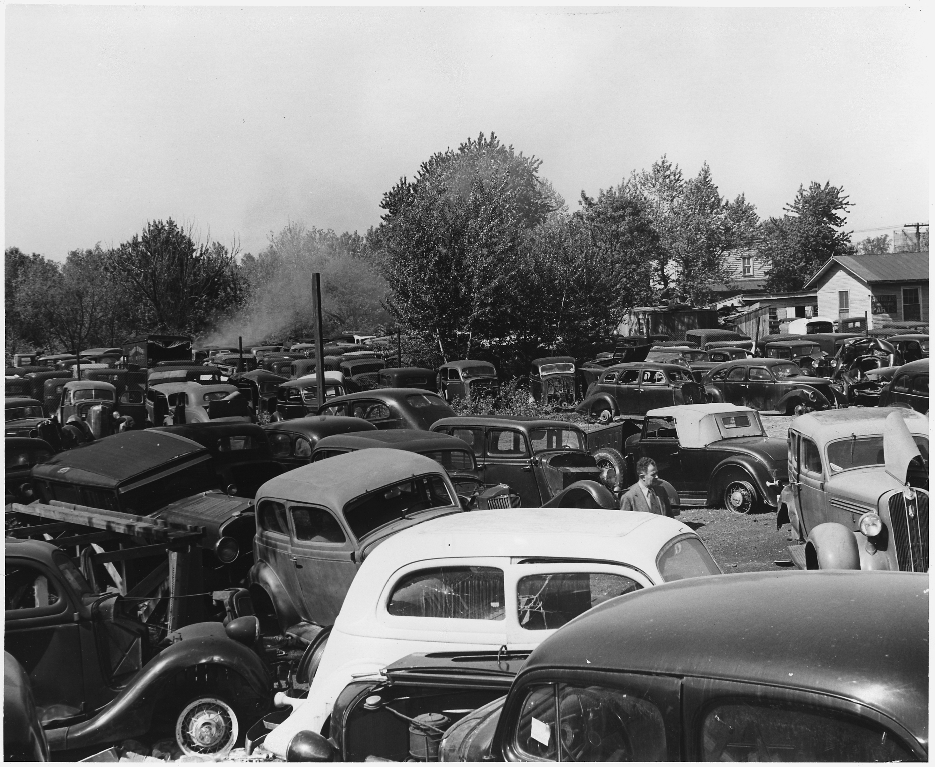 File:Hundreds of junked cars were denied to the war effort by the ...