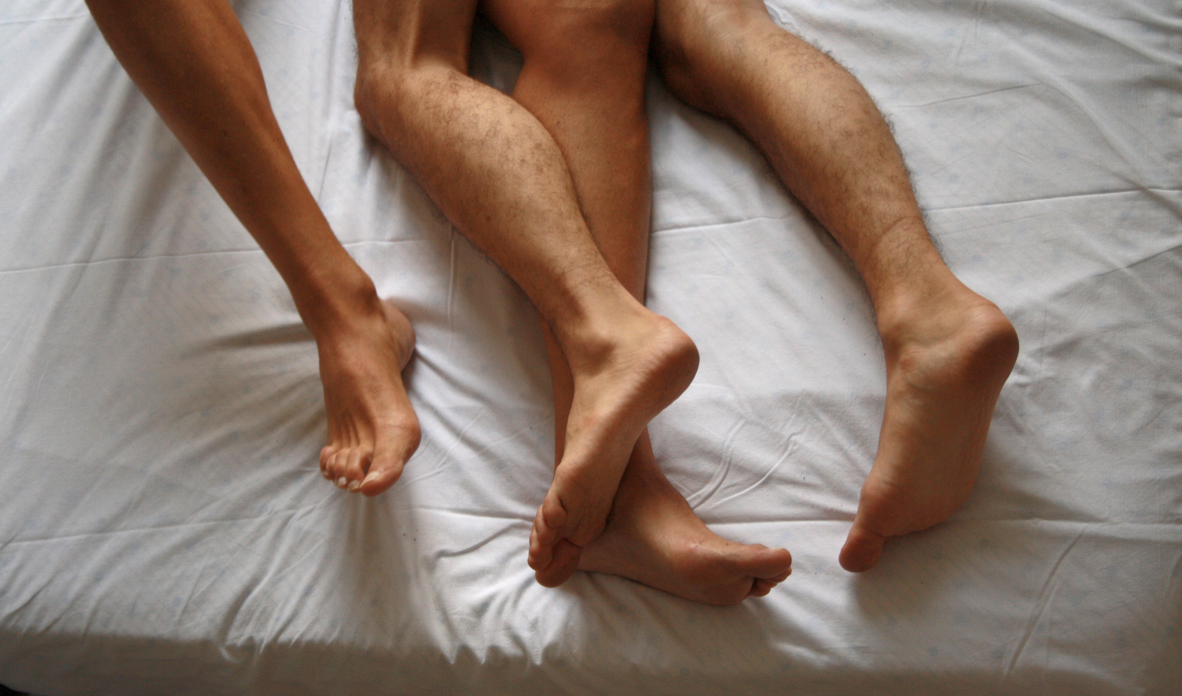 tow people having sex in bed