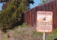 A photograph of a Neighborhood Watch sign in color
