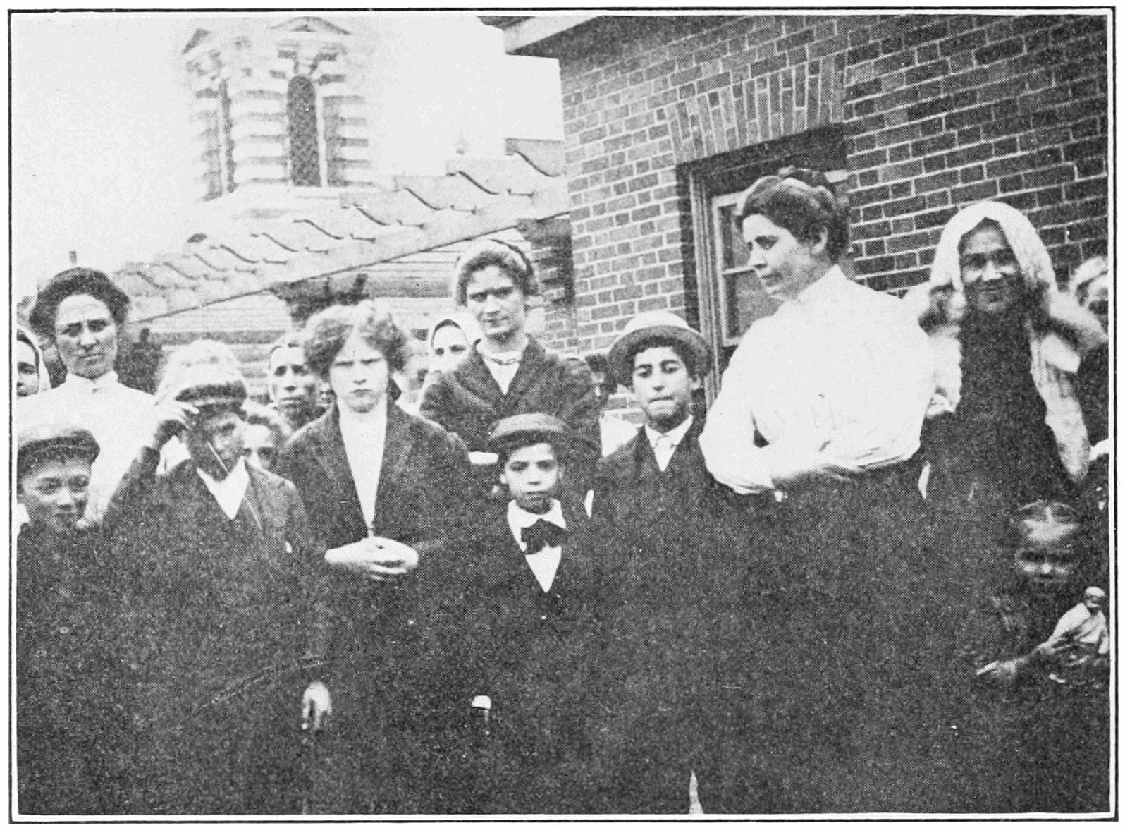 PSM V82 D016 A matron and her charges on the roof at ellis island.png