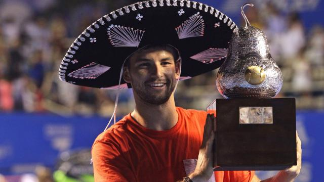 Dimitrov with the trophy at the Acapulco event Grigor Dimitrov s kupata si ot.jpg