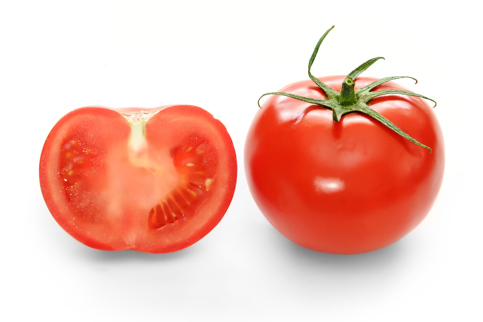 Image of a half and a whole tomato