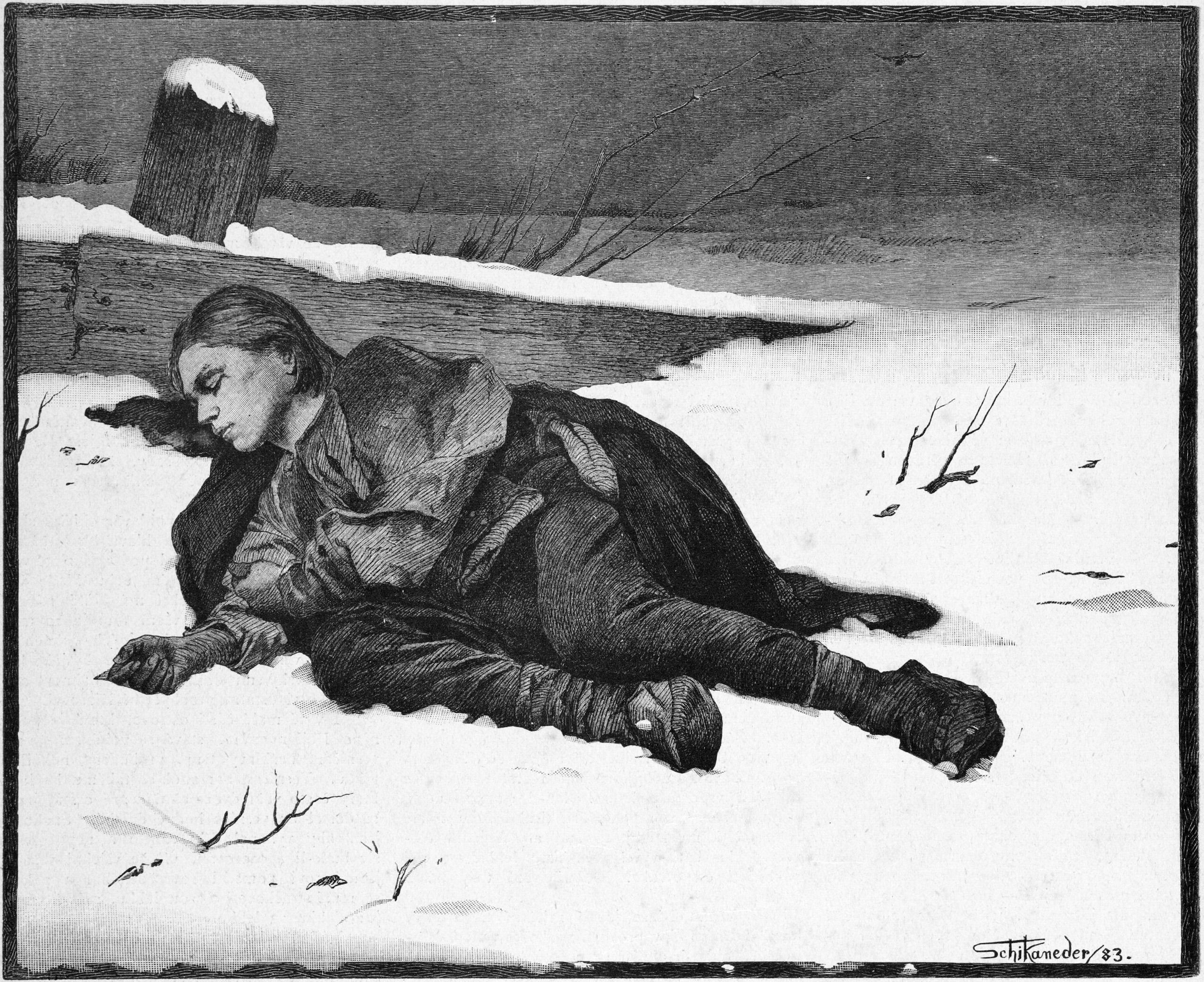 Ein erschöpfter Wanderer liegt im Schnee