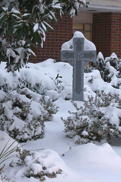 Snow covered Celtic cross in memorial garden.jpg