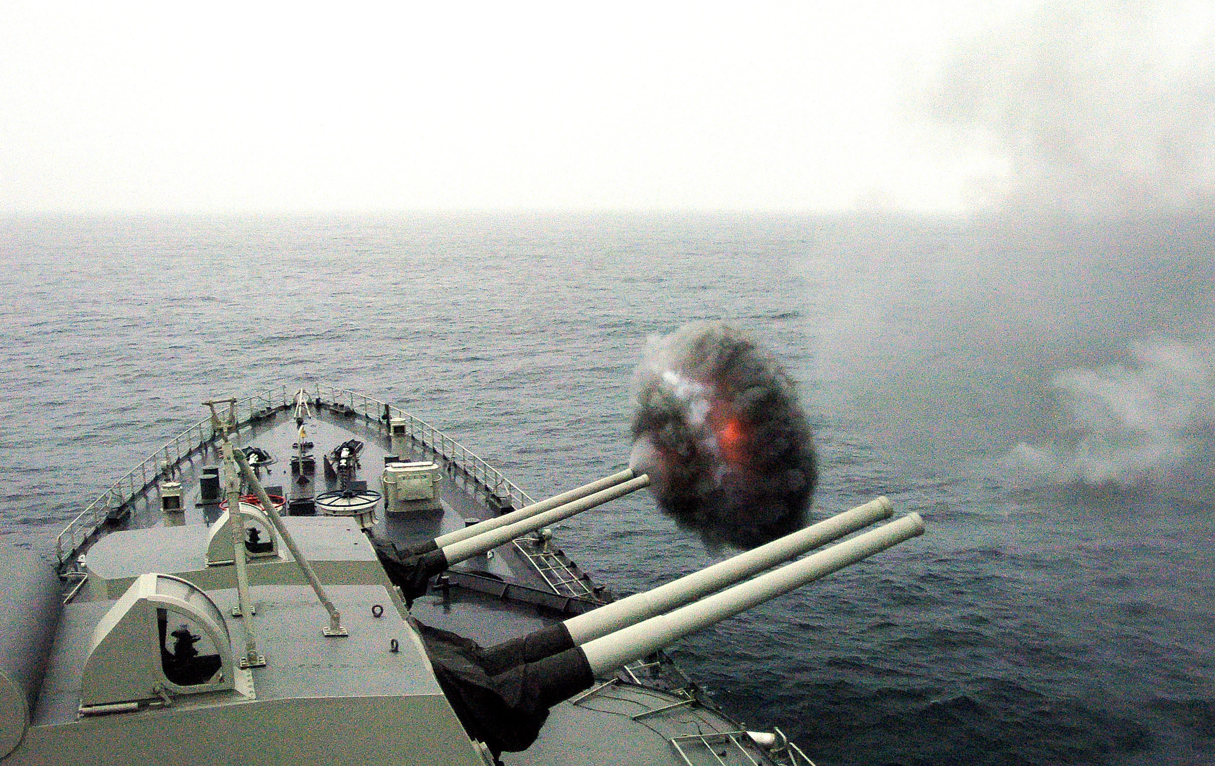 US Navy 040703-N-1464F-001 The Peruvian cruiser Almirante Grau CLM-81 fires one of its 15.2 cm caliber cannons